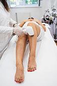 Woman receiving epilation treatment