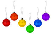 Christmas decoration hanging glass balls set LGBTQ community rainbow flag colors on white background isolated closeup, LGBT pride symbol, festive design element, gay, lesbian etc New Year holiday sign