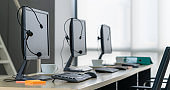 Call center computers and headsets all in office