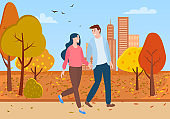 Man and Woman Walking Together in Autumn Park