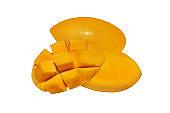 Two ripe yellow mango on white background isolated close up, one whole juicy tasty mango and half of cut diced, beautiful shiny sliced orange mango cubes, exotic tropical fruit design element