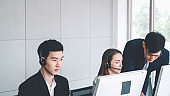Business people wearing headset working in office
