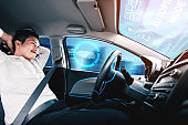 Self-drive autonomous car with man at driver seat.
