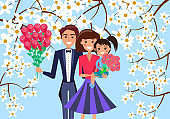 Father, Mother and Child Holds Bouquet of Flowers