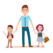 Father Stands and Holds Daughter's and Son's Hands