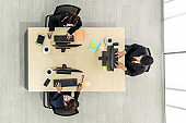 Business people wearing headset shot from top view