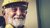 Senior factory worker or engineer close up portrait in factory