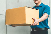 Delivery person carrying parcel box to send to customer