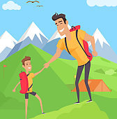 Boy climbing with his father in mountains
