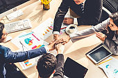 Happy business people celebrate teamwork success