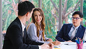 Smart businessman and businesswoman talking discussion in group meeting