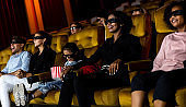Group of people watch 3d movie in cinema theater