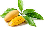 Delicious slide ripe yellow mango with green leaf isolated on white
