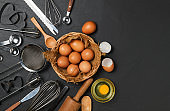 Fresh eggs in basket and Kitchen utensils for pastries