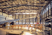 Wing and fuselage of the airplane in the aviation hangar