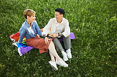 Lesbians have picnic outdoors