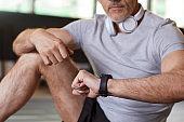 Man sitting in health club