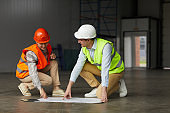 Engineers working with construction plan