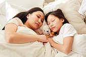 Family sleeping in bed