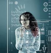 Woman analyze futuristic user interface . High tech screens data and information .
