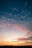 Cirrocumulus clouds sunset sky landscape at dusk