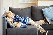 Little boy resting on sofa