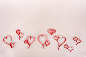 Valentines day hearts, gift box and greeting card over paper background.