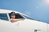 Serious calm airman sitting in a cockpit