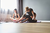 Group fitness lady in sportswear are stretching in sport club