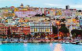 Cagliary cityscape and architecture with Mediterranean Sea in Sardinia Italy reflex