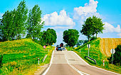 Scenery with car in road in Poland