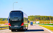 Black Tourist bus on road in Poland