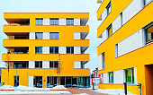Yellow Modern residential apartment and flat building exterior in Salzburg reflex