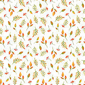Clusters of autumn red berries and fallen leaves. Seamless pattern with watercolor illustrations on a white background. Small print for fabric, textile, paper and other designs. Stock ornament with plants
