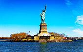 Liberty Island and Statue in New York reflex