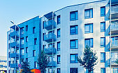 Trees near new apartment residential building with outdoor facilities Vilnius reflex