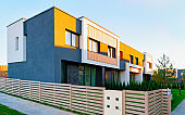 Apartment houses residential home architecture and entrance fence reflex