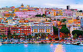 Cityscape with marina in Mediterranian sea Cagliari evening reflex