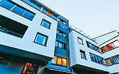 Detail of Modern residential apartment with flat building exterior