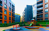 Residential apartment building architecture children playground reflex