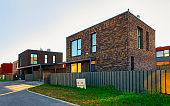 Apartment house residential home architecture with entrance fence reflex