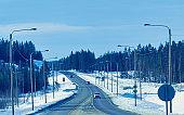 Cars on road in winter Rovaniemi