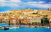 Cityscape and marina in Mediterranian sea in Cagliari reflex