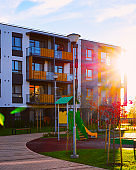 Apartment residential house facade architecture and kid playground sun light_new reflex