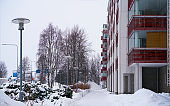 Modern apartment residential building wintertime Rovaniemi reflex