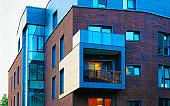New modern flat apartment building exterior reflex