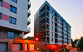 Modern residential apartment building architecture with garage night reflex