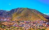 Buggerru city and mountains in South Sardinia reflex
