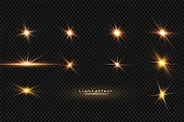Shining golden stars, sun isolated on a black background. Effects, glare, lines, glitter, explosion, golden light. Vector illustration