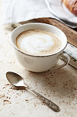 Coffee with milk on bright stone background. Close up.